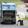 BEN GARVER — THE BERKSHIRE EAGLE<br /> Republic Services workers collect garbage on Dewey Ave in Pittsfield.