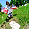 KRISTOPHER RADDER - BRATTLEBORO REFORMER<br /> Neve Pichette, a 7th-grader at St. Michael School,  knees down to place an American Flag next to a tombstone at Locust Ridge Cemetery, on Black Mountain Road, on Wednesday, May 23, 2018.