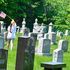 KRISTOPHER RADDER - BRATTLEBORO REFORMER<br /> Students from St. Michael School put up American flags next to veterans tombstones at various cemeteries around Brattleboro on Wednesday, May 23, 2018.