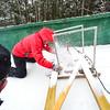 KRISTOPHER RADDER - BRATTLEBORO REFORMER<br /> Ken Barker uses the track setter as he craves the tracks into the inrun at the Harris Hill Ski Jump on Thursday, Feb. 16, 2017.