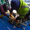 KRISTOPHER RADDER - BRATTLEBORO REFORMER<br /> Crews assemble the track setter before craving the tracks into the inrun at the Harris Hill Ski Jump on Thursday, Feb. 16, 2017.