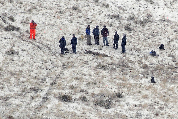 Search and recovery teams searched the debris field of the crash site Sunday morning.<br /> At least three people died Saturday afternoon after two planes, one of them pulling a glider, collided in north Boulder, scattering debris over 115 acres of open space.<br /> Cliff Grassmick / February 7, 2010