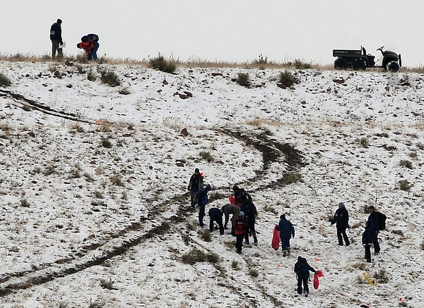 Investigators collect evidence at the crash site Sunday afternoon.<br /> At least three people died Saturday afternoon after two planes, one of them pulling a glider, collided in north Boulder, scattering debris over 115 acres of open space.<br /> Cliff Grassmick / February 7, 2010