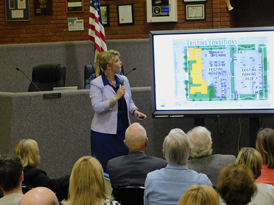 BOB FINNAN / GAZETTE Monica Sumner, vice president of architectural firm Brandstetter Carroll Inc., shows some of its plans for the new courthouse on Public Square at Monday's meeting at City Hall.