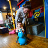 KRISTOPHER RADDER — BRATTLEBORO REFORMER<br /> Isaiah Levangie, 1, bounces around with help from his mother, Sarah Rattet, during Last Night Brattleboro, on Tuesday, Dec. 31, 2019.