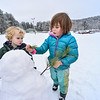 KRISTOPHER RADDER — BRATTLEBORO REFORMER<br /> Suzanna Hoskins, 4, of Dummerston, Vt. and Sol Birchard, 3, from Philadelphia, build a snowman at Living Memorial Park, on Dec. 31, 2019.