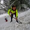 KRISTOPHER RADDER — BRATTLEBORO REFORMER<br /> Lt. Dan Hiner, of the Brattleboro Fire Department, and firefighter Matt Casabona clear a path around various hydrants around Brattleboro on Tuesday, Dec. 31, 2019.