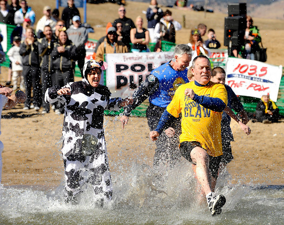 University of Northern Colorado Police Chief Mikel Longman, right, and the rest of his team charge into the water on Saturday, Feb. 26, during the Law Enforcement Torch Run Polar Plunge for Colorado Special Olympics at the Boulder Reservoir.<br /> Jeremy Papasso/ Camera