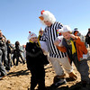 Athena Wright, of Grand Junction, and her two boys Wayne, right, and Parker dance in the sand on Saturday, Feb. 26, at the end of the Law Enforcement Torch Run Polar Plunge for Colorado Special Olympics at the Boulder Reservoir.<br /> Jeremy Papasso/ Camera