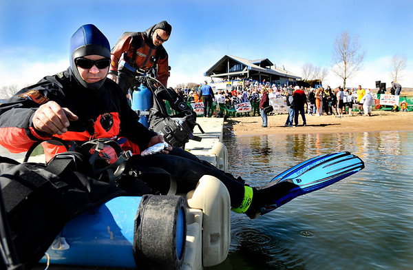 Boulder Fire Rescue firefighters Robert Boggess, left, and Glen Kice wait on the docks on Saturday, Feb. 26, before the start of the Law Enforcement Torch Run Polar Plunge for Colorado Special Olympics at the Boulder Reservoir.<br /> Jeremy Papasso/ Camera