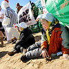 Wayne Wright, 6, at right, and his brother Parker, 5, watch the action while sitting in the sand on Saturday, Feb. 26, during the Law Enforcement Torch Run Polar Plunge for Colorado Special Olympics at the Boulder Reservoir.<br /> Jeremy Papasso/ Camera