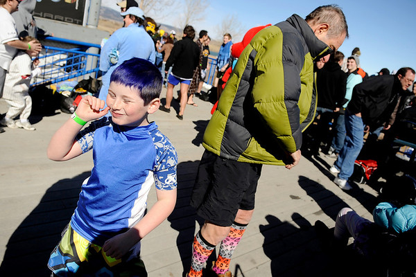 Zeke Hersch, 8, left, and his grandfather Gilbert Hersch, 69, both of Denver prepare themselves to head down to the shore on Saturday, Feb. 26, during the Law Enforcement Torch Run Polar Plunge for Colorado Special Olympics at the Boulder Reservoir.<br /> Jeremy Papasso/ Camera