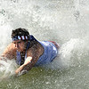 A participant dives into the frigid water on Saturday, Feb. 26, during the Law Enforcement Torch Run Polar Plunge for Colorado Special Olympics at the Boulder Reservoir.<br /> Jeremy Papasso/ Camera