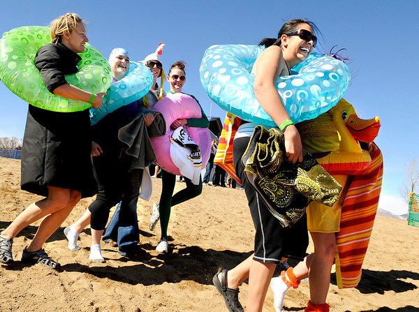 Ro Medina, of Arvada, right, walks toward the waters edge with the rest of her team the Steez Bucks on Saturday, Feb. 26, during the Law Enforcement Torch Run Polar Plunge for Colorado Special Olympics at the Boulder Reservoir.<br /> Jeremy Papasso/ Camera