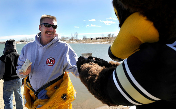 University of Colorado's Chip hands some coffee to Boulder Fire Rescue's Dave Richter on Saturday, Feb. 26, during the Law Enforcememt Torch Run Polar Plunge for Colorado Special Olympics at the Boulder Reservoir. Richter was in a wet suit in case of an emergency.<br /> Jeremy Papasso/ Camera