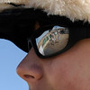 The reflection of participants is seen in the sunglass reflection of Jason seper, 14, of Longmont,  on Saturday, Feb. 26, during the Law Enforcement Torch Run Polar Plunge for Colorado Special Olympics at the Boulder Reservoir.<br /> Jeremy Papasso/ Camera