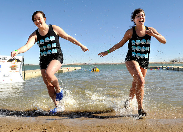University of Colorado students Annie Vlosich, left, and Remy Groh run out of the cold water on Saturday, Feb. 26, during the Law Enforcement Torch Run Polar Plunge for Colorado Special Olympics at the Boulder Reservoir.<br /> Jeremy Papasso/ Camera