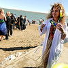 Terri Beach, of Erie, walks towards the line of people waiting to enter the icy water on Saturday, Feb. 26, during the Law Enforcement Torch Run Polar Plunge for Colorado Special Olympics at the Boulder Reservoir.<br /> Jeremy Papasso/ Camera