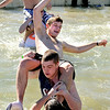 Participants goof off in the cold water on Saturday, Feb. 26, during the Law Enforcement Torch Run Polar Plunge for Colorado Special Olympics at the Boulder Reservoir.<br /> Jeremy Papasso/ Camera