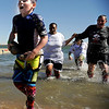 Zeke Hersch, 8, of Denver, shows his exhaustion after exiting the cold water on Saturday, Feb. 26, during the Law Enforcement Torch Run Polar Plunge for Colorado Special Olympics at the Boulder Reservoir.<br /> Jeremy Papasso/ Camera