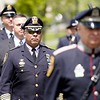 BEN GARVER — THE BERKSHIRE EAGLE<br /> Pittsfield Police Chief Michael Wynn joins local law enforcement in a show respect for fallen officers during the Police Memorial Day celebration in Pittsfield on the Common, Wednesday, May 15, 2019.  In 1962, President John F. Kennedy signed a proclamation which designated May 15 as Peace Officers Memorial Day.