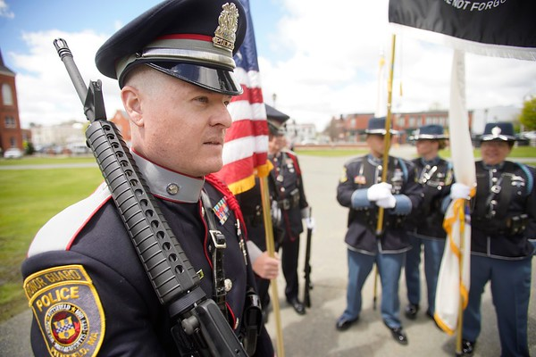 BEN GARVER — THE BERKSHIRE EAGLE<br /> Pittsfield Police Sgt. Ryan Williamson prepares to march in the Police Memorial Day Ceremony with the Honor Guard. <br /> Local law enforcement in show respect for fallen officers during the Police Memorial Day celebration in Pittsfield on the Common, Wednesday, May 15, 2019.  In 1962, President John F. Kennedy signed a proclamation which designated May 15 as Peace Officers Memorial Day.
