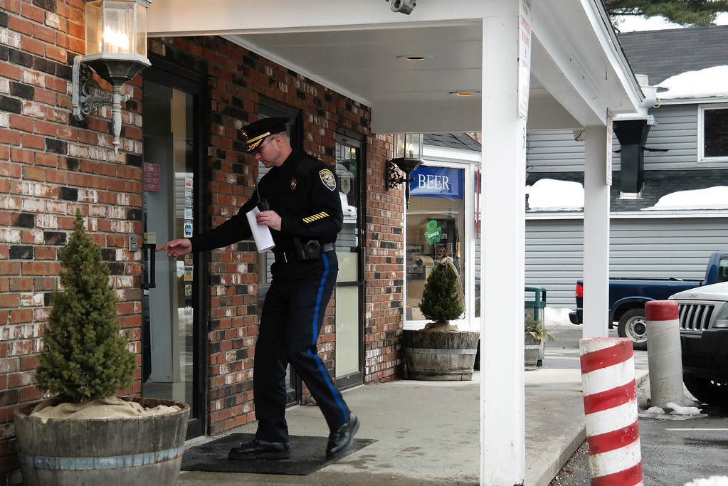 . Stockbridge Police Chief Robert Eaton enters the Lee Bank branch located on Elm Street in Stockbridge to investigate an alleged robbery that took place there Monday afternoon. Ben Garver/Berkshire Eagle Staff Monday, March 10, 2014