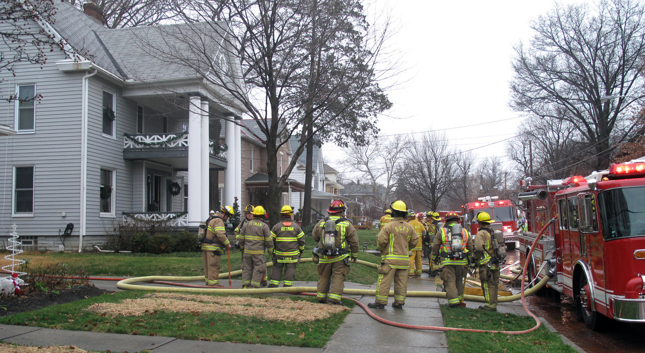 KATIE ANDERSON / GAZETTE Multiple fire crews gather outside a house at162 Highland Ave., Wadsworth, where fire broke out in the basement Sunday afternoon.