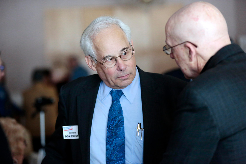 . Candidate Don Berwick talks with supporters at a Democratic party gubernatorial candidate meet-and-greet held by the Berkshire Brigades at the ITAM lodge in Pittsfield. Sunday, January 26, 2014. (Stephanie Zollshan | Berkshire Eagle Staff)
