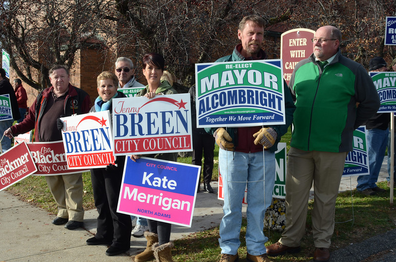 Mayor Richard Alcombright joins other candidates and supporters outside of the polling station at the St. Elizabeth of Hungary Parish Center in North Adams on voting day, Tuesday November 5, 2013. (Gillian Jones/North Adams Transcript)