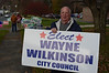 City Council Candidate Wayne Wilkinson holds his sign outside of Ward 4 at Greylock Elementary School on Tuesday November 5, 2013. (Gillian Jones/North Adams Transcript)