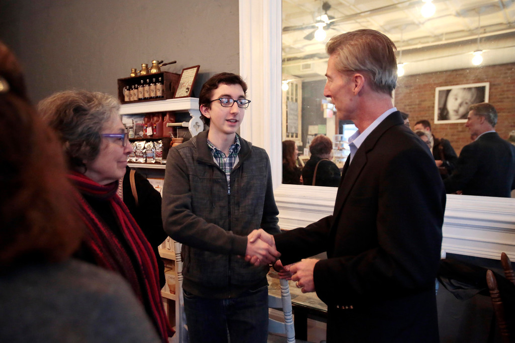 . Tom Conroy meets Jacob Edelman and other supporters at Dottie\'s Cafe in Pittsfield during a stop on his campaign trail for state treasurer. Sunday, January 12, 2014. (Stephanie Zollshan | Berkshire Eagle Staff)