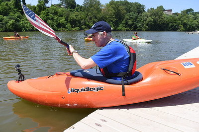 KRISTIN BAUER | GAZETTE Senator Rob Portman takes to the water for a game of kayak football at Merwin's Warf, in Cleveland, while rowing with the Team River Runner and Paddling for Patriots groups.