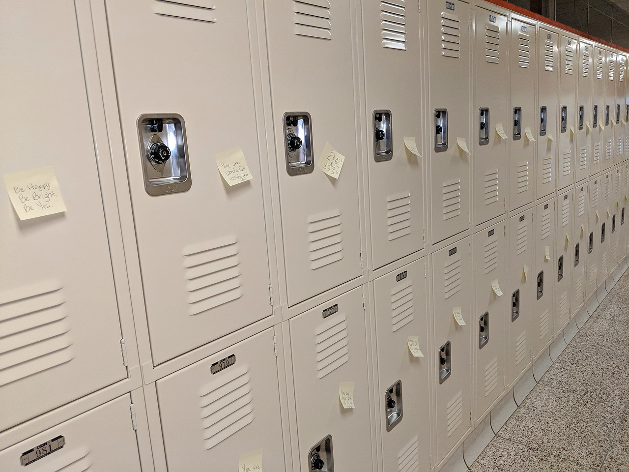 CINDY BREDA / GAZETTE Former Buckeye school board member Kim Cecelich spearheaded Monday's Post-It Note project as a way to let students know they are loved. More than 1,200 hand-written notes with encouraging messages were placed on lockers at the high school to help students feel good about themselves when they return from spring break today.
