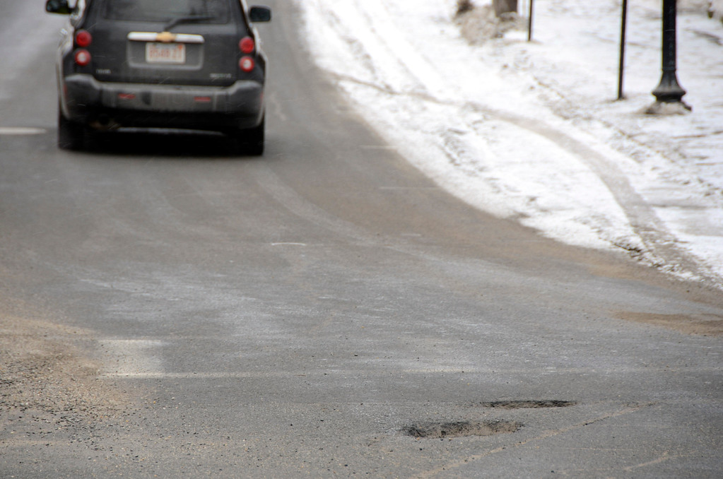 . It is that time of year again for potholes. These are at Monument Square at the intersection of Church, East Main and Main Streets in North Adams. Gillian Jones/Berkshire Eagle Staff