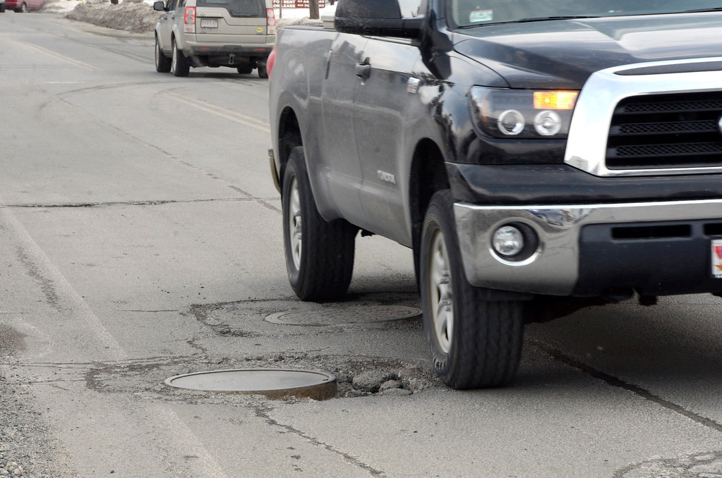 . It is that time of year again for potholes. These are on Elm Street in Pittsfield. Gillian Jones/Berkshire Eagle Staff