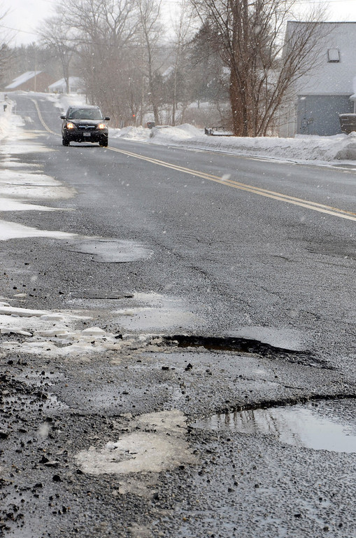 . It is that time of year again for potholes. These are on East Road Adams. Gillian Jones/Berkshire Eagle Staff