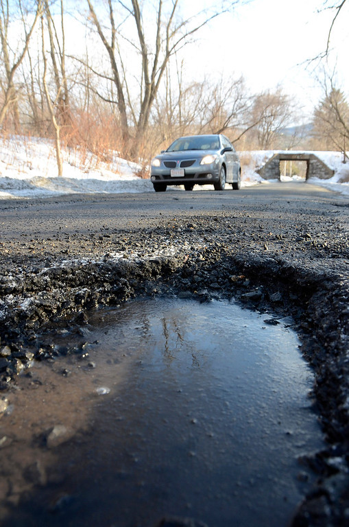 . It is that time of year again for potholes. These are on Demond Avenue in North Adams. Gillian Jones/Berkshire Eagle Staff