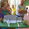 ELODIE REED - FOR THE BENNINGTON BANNER Pownal Historical Society board member Joyce Held holds a model of the proposed new town hall, which would combine modular construction and the 1840's School House #8.