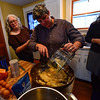 KRISTOPHER RADDER - BRATTLEBORO REFORMER<br /> Christina Mansfield puts sliced up potatoes into a mixing dish as they prepare potato latkes on Sunday, Dec. 10, 2017.