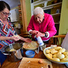 KRISTOPHER RADDER - BRATTLEBORO REFORMER<br />  Selma Schiffer and Deb Schiller work together as they mix ingredients for the potato latkes.