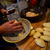 A small group of people gathers at a home in Brattleboro to prepare potato latkes for a Hanukkah event at Congregation Shir Heharim on Friday, Dec. 15, 2017, at 6 p.m.
