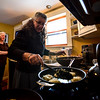 KRISTOPHER RADDER - BRATTLEBORO REFORMER<br /> Laura Berkowitz keeps an eye on the potato latkes as they cook on the stove top.