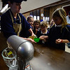 KRISTOPHER RADDER - BRATTLEBORO REFORMER<br /> Bobbi-Jo Anderberg helps pour cooking oil for Amelia Knowles as they make cookies on Wednesday, Jan. 31, 2018, for St. Brigid's Kitchen. The students will serve the meals to around 140 guests at Saint Brigid's Kitchen on Thursday.