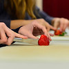 KRISTOPHER RADDER - BRATTLEBORO REFORMER <br /> Mary Mazzer, sixth grader, and Alicia Chechile, seveth grader, cut up strawberries on Wednesday, Jan. 31, 2018, for St. Brigid's Kitchen. The students will serve the meals to around 140 guest at Saint Brigid's Kitchen on Thursday.