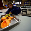 KRISTOPHER RADDER - BRATTLEBORO REFORMER <br /> Jason Borst, eighth grader at St. Michael Catholic School, cuts up cantaloup on Wednesday, Jan. 31, 2018, for St. Brigid's Kitchen. The students will serve the meals to around 140 guest at Saint Brigid's Kitchen on Thursday.