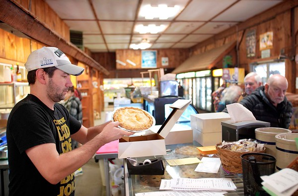 BEN GARVER — THE BERKSHIRE EAGLE<br /> Paul Tawczynski prepares a pie order in front of a line of customers at Taft Farms in Great Barrington, Tuesday, November 26, 2019.