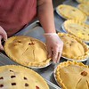 BEN GARVER — THE BERKSHIRE EAGLE<br /> Nancy Hiser finishes a variety of pies for the 1400 orders to be filled at Taft Farms in Great Barrington, Tuesday, November 26, 2019.