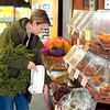 BEN GARVER — THE BERKSHIRE EAGLE<br /> Julie Rubiner holds a wreath while picking up some cider doughnuts at Taft Farms in Great Barrington, Tuesday, November 26, 2019.