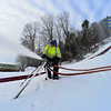 KRISTOPHER RADDER - BRATTLEBORO REFORMER <br /> Jason Evans, of Evans Construction, adjusts the snow blowers at Harris Hill Ski Jump.